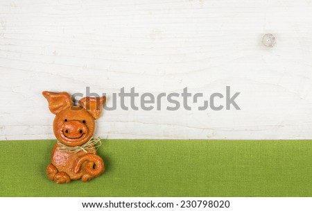 Witty and humorously new years greeting card with a handmade pig of salt paste with a green frame. - stock photo