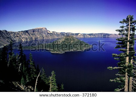 Wizard Island in Crater Lake Oregon - stock photo