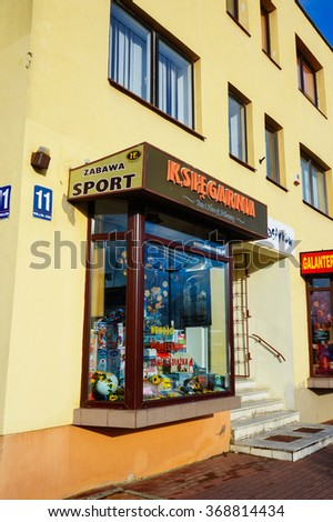 WLADYSLAWOWO, POLAND - NOVEMBER 12, 2015: Entrance to a toys and book store by a sidewalk