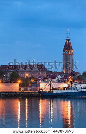 Wladyslawowo town skyline in Pomerania, Poland at night, view from the sea port