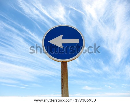 Wndy Clouds and One Way Sign On The Evening Atlantic Ocean Sky