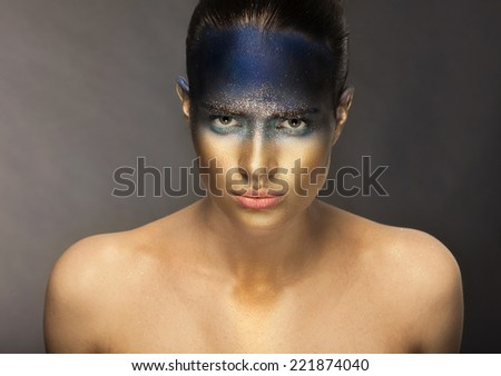 Woaman with the golden face - stock photo