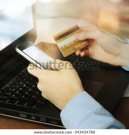 wocomputer laptop for online shopping or reporting lost card - stock photo