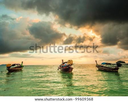 Woden boat at sunrise. Ko Lipe island in Thailand - stock photo