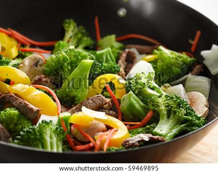 wok stir fry closeup - stock photo