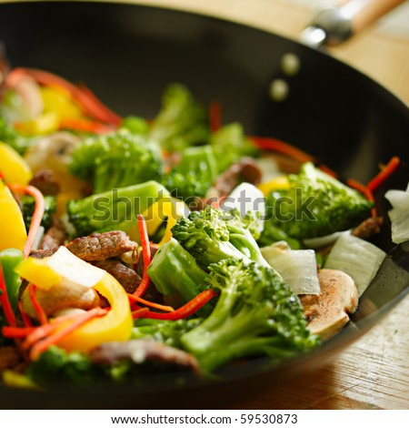 wok stir fry with selective focus