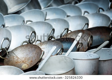 Woks and pans for sale in a shop in Nepal - stock photo