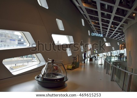 WOLFSBURG, GERMANY - APRIL 15, 2016. Interior view of Phaeno science center in Wolfsburg, with exhibits, glass windows and people.
