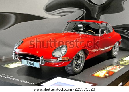 WOLFSBURG, GERMANY - AUGUST 14, 2014: British retro vehicle Jaguar E-Type at the museum of the Volkswagen Autostadt. - stock photo