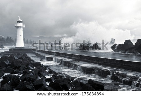Wollongong lighthouse providing safe harbor - stock photo