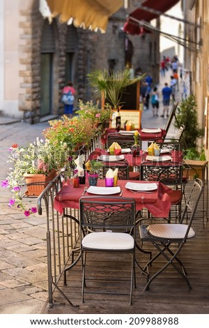 Wolterra - outdoor dining nook in Tuscany, Italy - stock photo