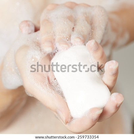 Woman'a hand with soap - stock photo