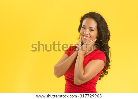 Woman a red blouse on a yellow background
