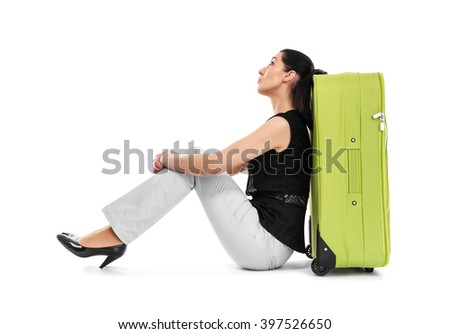 Woman abuts her back in a suitcase on a white background. - stock photo