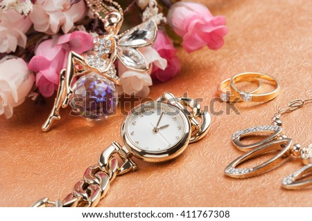 woman accessories, closeup shiny gold women wristwatch