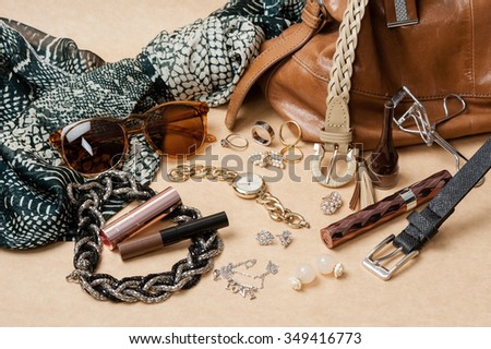 woman accessories on brown background