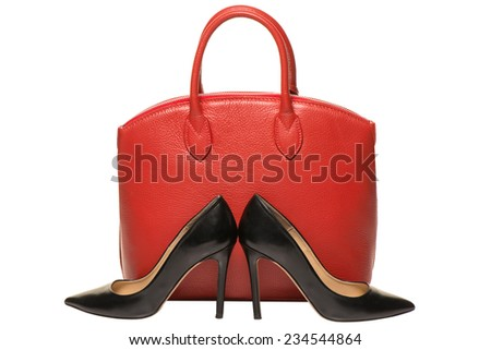 Woman accessories on white background, red handbag and black stileto - stock photo