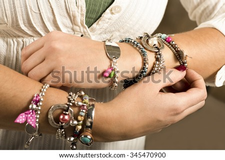 Woman adjusting bracelets