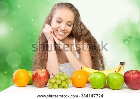 Woman admiring her fruit.