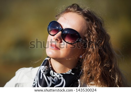 Woman against a nature background - stock photo