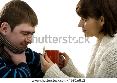 Woman allows to drink a medical drink to the ill man, isolated on white - stock photo
