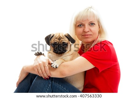 Woman and a pug - stock photo