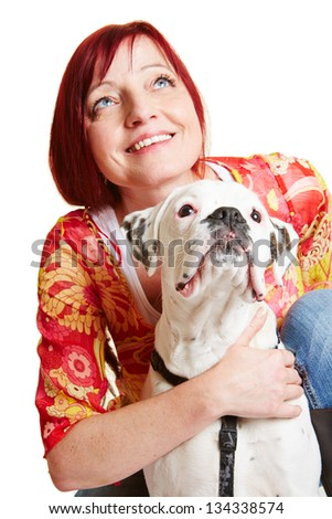 Woman and boxer dog looking up together in the same direction - stock photo
