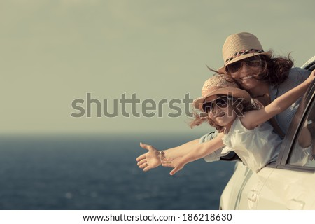 Woman and child at the beach. Summer vacations concept - stock photo