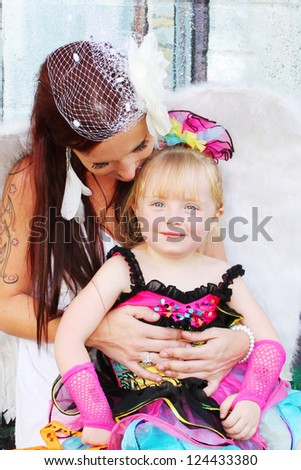 Woman and child dressed in costumes for Halloween