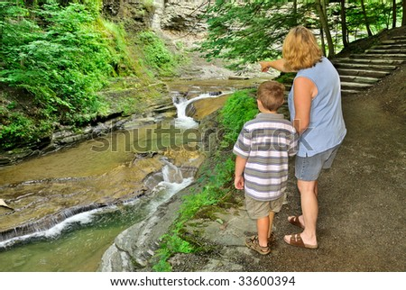 Woman and child enjoying view at park - stock photo