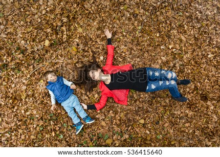 woman and child lying on forest floor