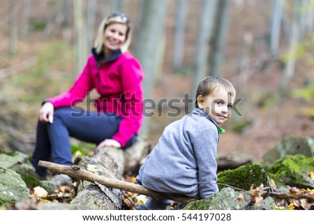 Woman and child on a hike in the woods.