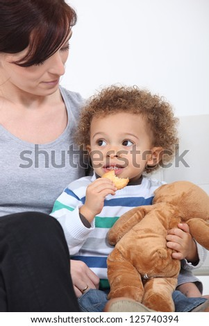 Woman and child with a teddy bear - stock photo