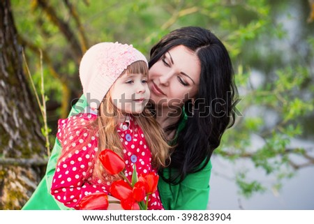 Woman and child with bouquet of flower