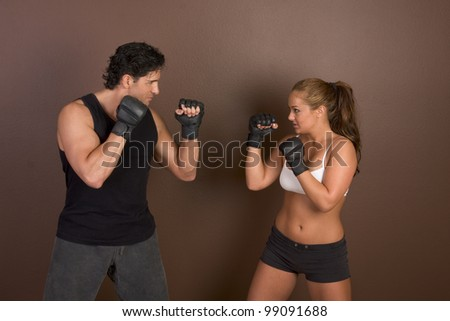 Woman and coach are boxing - stock photo