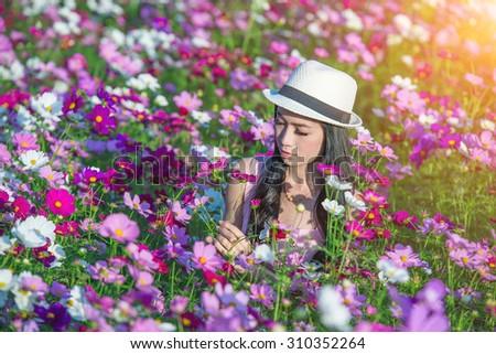 Woman and cosmos flowers.
