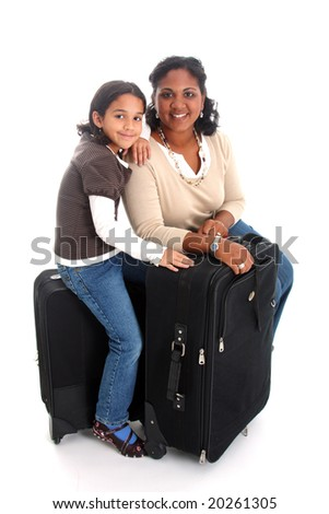 Woman and daughter with their suitcases ready to travel
