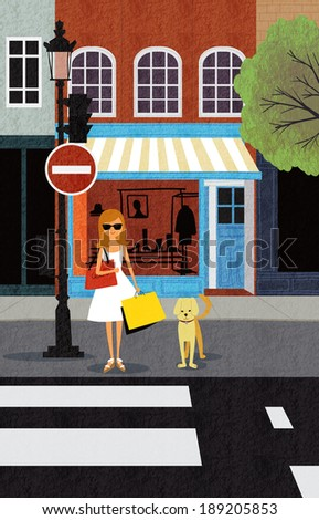woman and dog standing at crosswalk