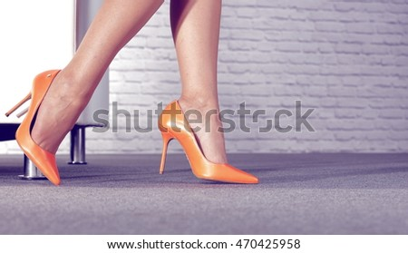 woman and floor and sofa