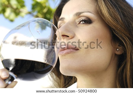 Woman and glass of wine - stock photo