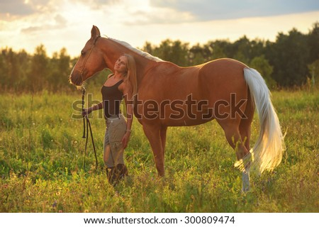 Woman and golden horse - stock photo