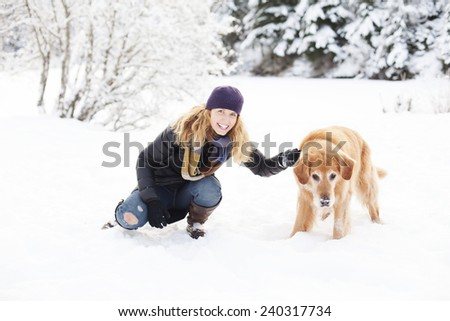Woman and golden retriever - stock photo