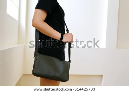 woman and green leather bag