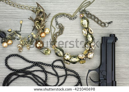 Woman and gun, Pistol and woman accessories, Handgun and accessories, Stylish set for girls. Women accessories, Still life of fashion woman. (Color Process) - stock photo
