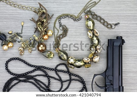 Woman and gun, Pistol and woman accessories, Handgun and accessories, Stylish set for girls. Women accessories, Still life of fashion woman. - stock photo