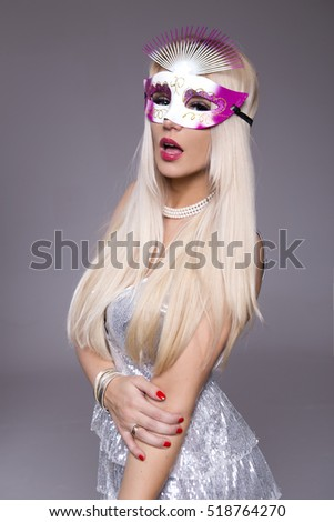 Woman and Happy 2017. beautiful woman in evening dress with mask