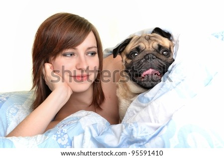 Woman and her dog  in the bed - stock photo