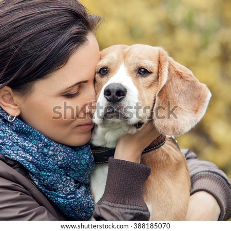 Woman and her favorite dog portrait - stock photo