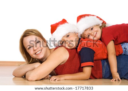 Woman and her kids in a pile on the floor at christmas time - isolated - stock photo