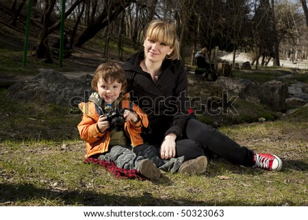 Woman and her son posing at camera